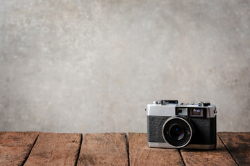Retro camera on wooden board with copyspace