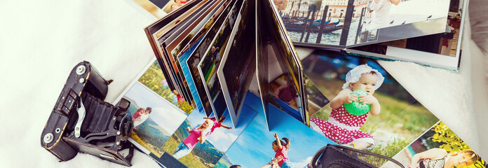 Photo album with photos of travel and vintage old camera on a background Wall mural