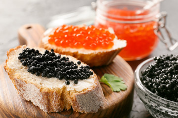 Sandwiches with delicious caviar on board, closeup