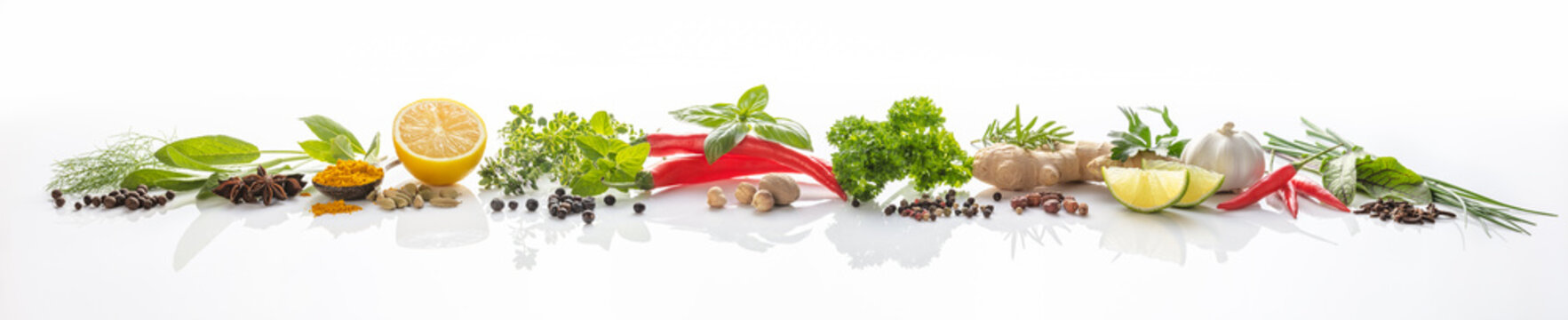 Composition of various herbs and spices on white background