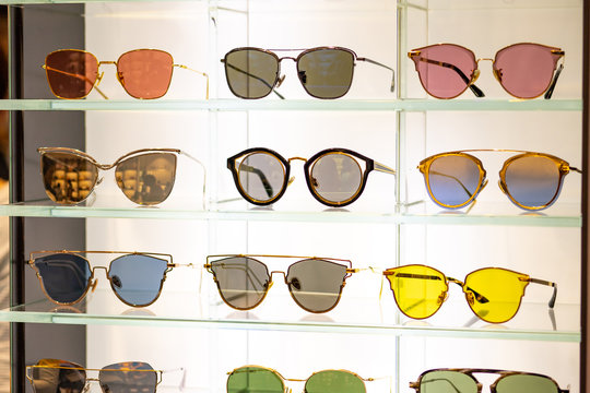 Many beautiful and colorful sunglasses displaying in store