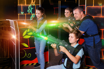 Kids and adults playing lasertag