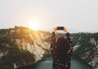 woman travel and taking pictures at canyon, thailand
