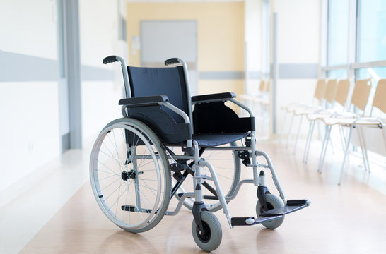Empty wheelchair in hospital corridor