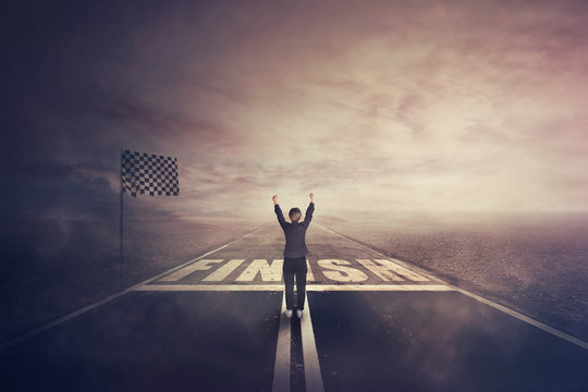 Competitive woman, raising hands up, celebrate on the road as crossing the finish line. Surreal challenge winning concept, motivation and success