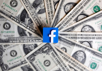 A 3-D printed Facebook logo is seen on U.S. dollar banknotes in this illustration picture