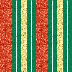 Vibrant red, gold and white dotted vertical striped design. Seamless geometric vector pattern on textured green background. Great for Christmas, seasonal products, packaging, stationery giftwrap