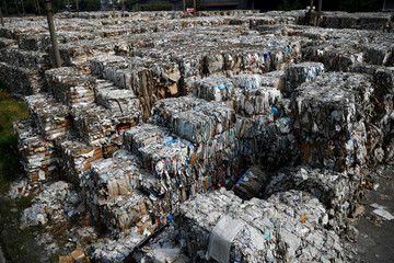Piles of paper waste, imported by a paper factory, are seen in Mojokerto