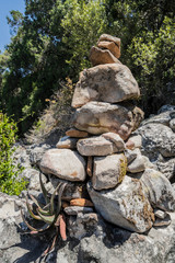 Stacked stones as a guide for hikers. Table Mountain National Park in Cape Town, South Africa.