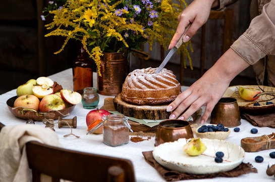 beautiful outdoor still life in country garden with bundt cake on wooden stand on rustic table