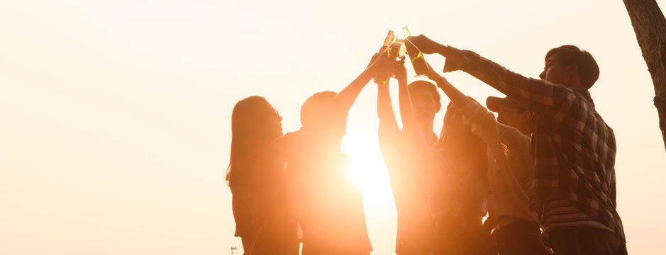 Six young entrepreneur gathering together toast for success in business start up, group party at dusk, cropped dimension for banner