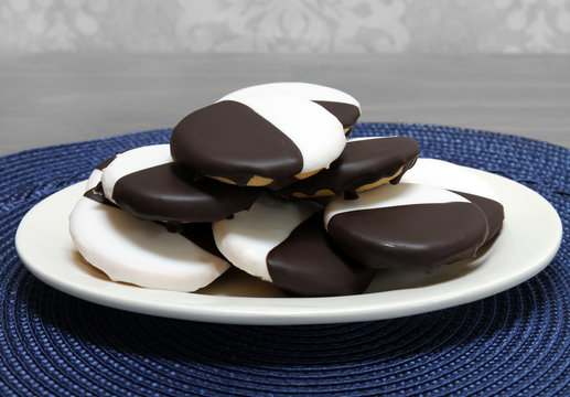 Black and White cookies on an oval plate.