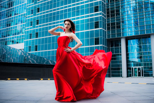 Gorgeous woman in red fluttered dress. Freedom concept. Red Moscow
