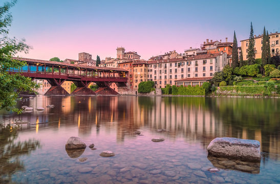 Bassano del Grappa during the sunset with city reflections on Brenta River