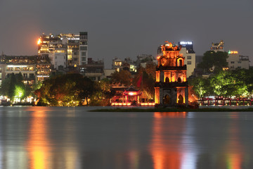Illuminated Turtle Tower (Thap Rua) in the middle of Hoan Kiem lake located in Hanoi, Vietnam Wall mural