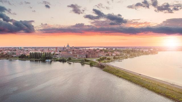 Aerial shot of UNESCO World Heritage site Mantua city at sunset