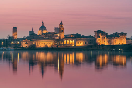 UNESCO World Heritage site Mantua city with pink sky at sunset with city reflections on the Mincio River