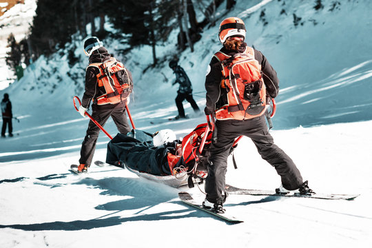 Rescuers at a ski resort evacuate the victim from the slope.