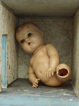 broken antique doll