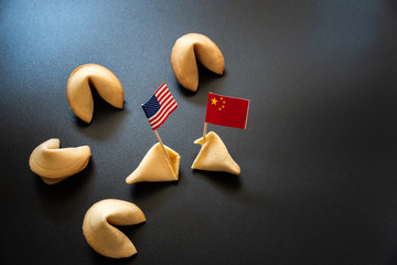 Chinese fortune cookies next to American flag, concept of international trade between USA and China.