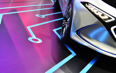 Wall Mural - Detail on one of the LED headlights modern electric car