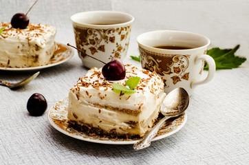 Tiramisu, a traditional Italian dessert in a light background. Close-up