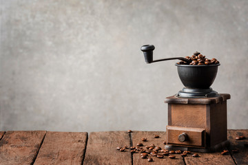Retro coffee grinder on wooden table