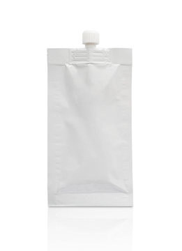 Blank white cosmetic cream sachet with plastic cap isolated on white background