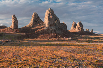 Trona Pinnacles are nearly 500 tufa spires hidden in California Desert National Conservation Area, not far from the Death Valley National Park, California, USA. Sunset landscape with beautiful rocks.