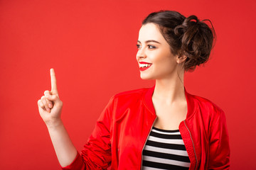 Emotional brunette girl on a red background Wall mural