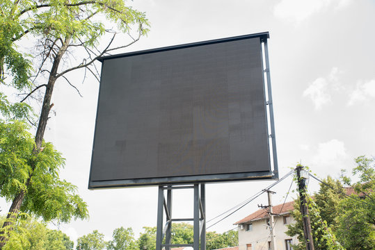 Big black led billboard commercial advertisement sign with electric panels and displays