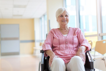 Senior woman sitting in her wheelchair in hospital