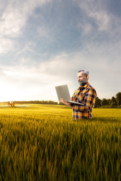 Beautiful senior farmer use new technology for agronomy