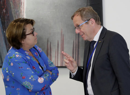 European Space Agency Director General Woerner talks to OOSA Director di Pippo in Vienna