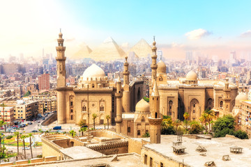 The Mosque-Madrassa of Sultan Hassan and the Pyramids on the background, beautiful view of Cairo, Egypt Wall mural