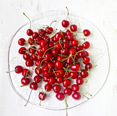 Red cherries ripe and sweet on a glass plate ready to eat