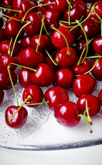Red cherries ripe and sweet on a glass plate ready to eat, close up