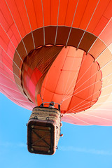Acrylic Prints Sky sports Red hot air balloon, view from ground