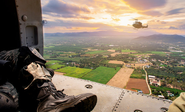 Thai Army soldiers prepared jumping from the helicopter at the open field operation site.