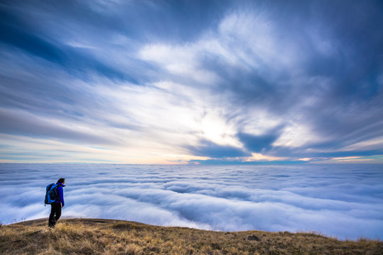 A female backpacker stands above the clouds at Steptoe Butte in eastern Washington.