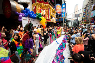 Drag Queens set a Guinness World Record for the longest feathered boa at 1.2 miles, along 42 St, in Times Square in New York