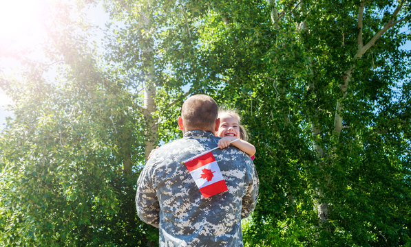 Happy reunion of soldier from Canada with family, daughter hug father