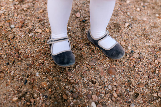 legs of girl with shoes in a park