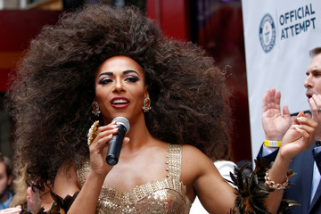 Drag Queen Shangela speaks, before an event to set a Guinness World Record for the longest feather boa at 1.2 miles, along 42 St, in Times Square in New York
