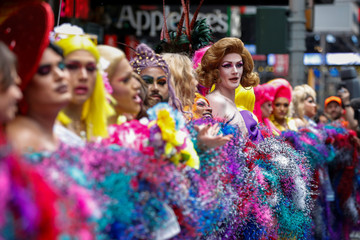 Drag Queens set a Guinness World Record for the longest feather boa at 1.2 miles, along 42 St, in Times Square in New York