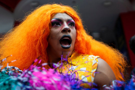 A Drag Queen helps to set a Guinness World Record for the longest feather boa at 1.2 miles, along 42 St, in Times Square in New York