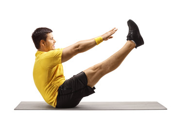 Young man stretching on an exercise mat
