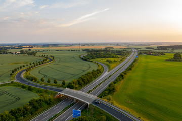 road and german highway or autobahn, agricultural fields and meadows