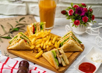 Club sandwich served with french fries.