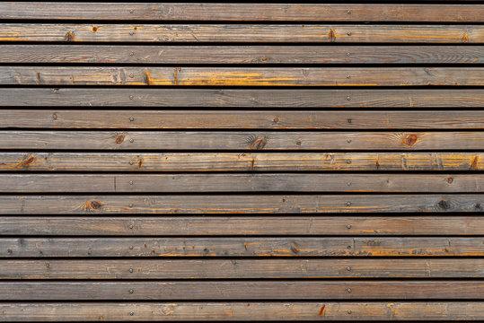Exterior timber facade, architectural wood facade, rough timber texture, wood cladding, teak wood wall, old wood horizontal pattern.